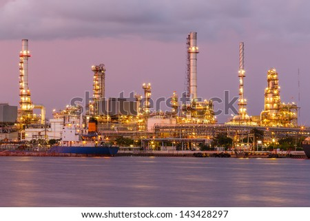 twilight oil refinery and port big boat transport - stock photo