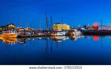 Twilight reflections in a marina in Harbor East, Baltimore, Maryland. - stock photo