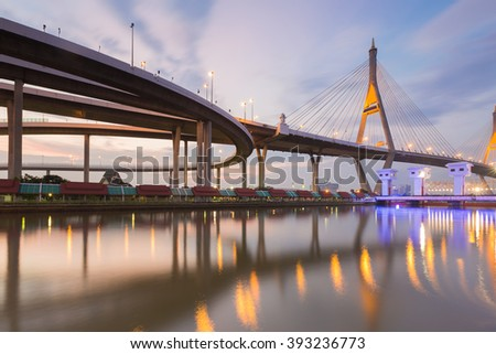 Twilight, Suspension bridge connect to elevated road waterfront, Bangkok Thailand - stock photo