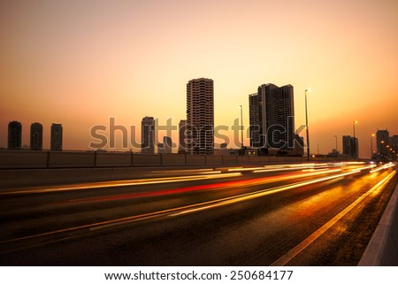 Twilight time traffic light in the city - stock photo