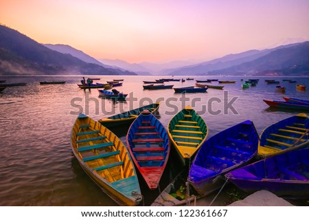 twilight with boats on Phewa lake, Pokhara, Nepal - stock photo