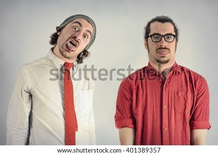 Twin adult men with beards making funny faces - stock photo