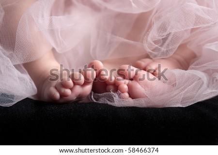 Twin baby girls feet - stock photo