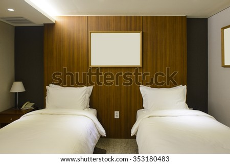 Twin bed hotel room interior - stock photo