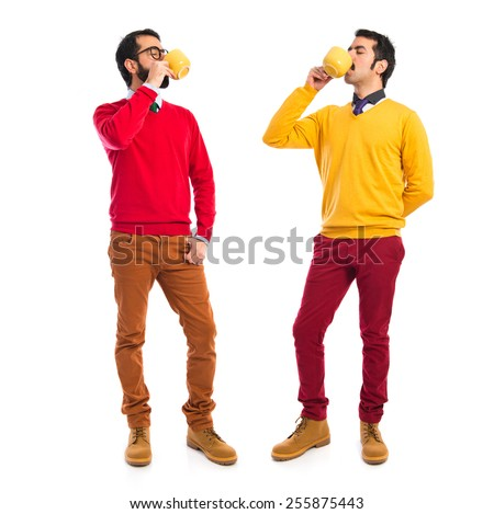 Twin brothers holding cup of coffee  - stock photo