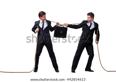 Twin brothers in tug of war concept isolated on white - stock photo