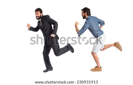 Twin brothers running fast over white background - stock photo