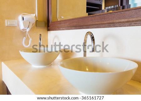 twin ceramic sinks in luxury villa. - stock photo