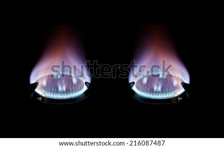 twin gas hobs burning fuel - stock photo