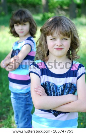 twin girls have an argument - stock photo