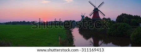 Twin mills of Greetsiel/Germany - stock photo