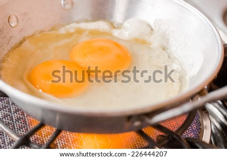 Twin of fried egg - stock photo