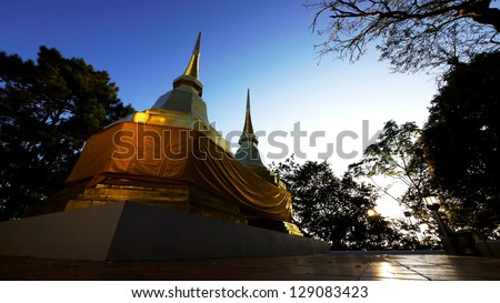 Twin Pagoda at Wat Phra That Doi Tung, Chiang Rai, Thailand. - stock photo
