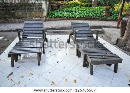 twin pool daybeds - stock photo