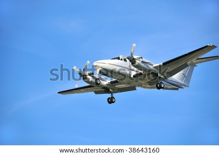 twin turboprop corporate and passenger utility aircraft.  this model is the Raytheon beechcraft king air 200 with a distinctive t shaped tail and is one of the most successful sellers in its class - stock photo
