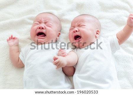 Twins brother baby crying - stock photo