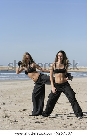 twins training in the beach - stock photo