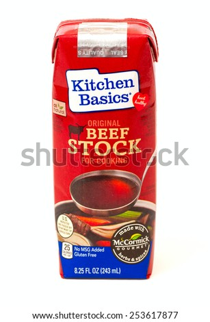 TWINSBURG, OH, USA - FEBRUARY 7, 2015: A package of Kitchen Basics Beef Stock on white. This beef broth is marketed as a heart-healthy option, being gluten free and containing no MSG. - stock photo