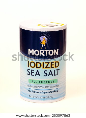 TWINSBURG, OH, USA - FEBRUARY 7, 2015: A package of Morton Iodized Sea Salt on white. This fairly recent addition to the Morton line hopes to capitalize on the popularity of sea salt. - stock photo