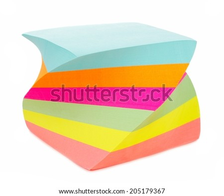 Twirled note pad of sticky notes isolated on white - stock photo
