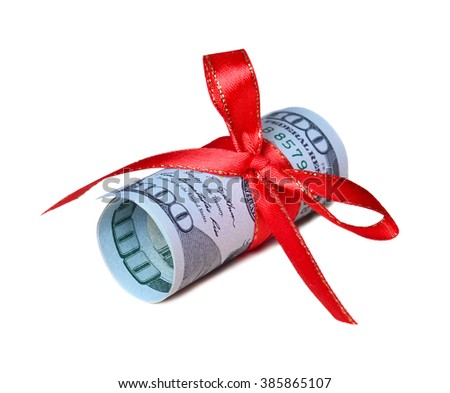 twisted 100 dollars a red ribbon - stock photo