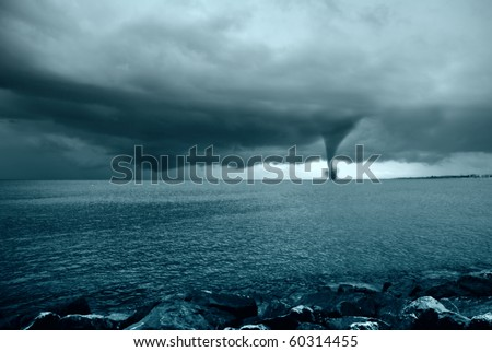 twister incoming from the ocean - stock photo