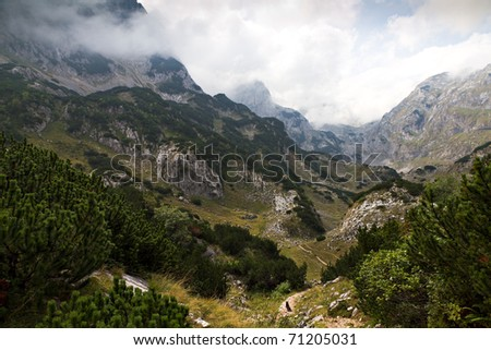Twisting hiking trail in rough, rocky, back country of UNESCO world heritage National Park Durmitor, Montenegro - stock photo