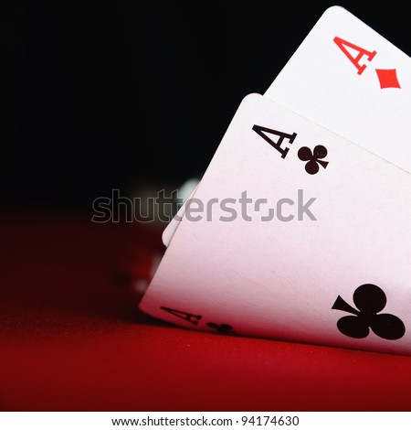 two aces with blurry chips and background - stock photo