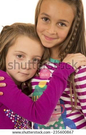 Two adorable  girls hugging wearing winter pajamas - stock photo