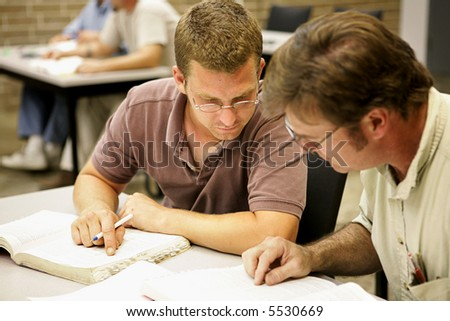 Two adult education students studying together in class. - stock photo