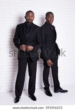 two african man businessmen in black suit - stock photo