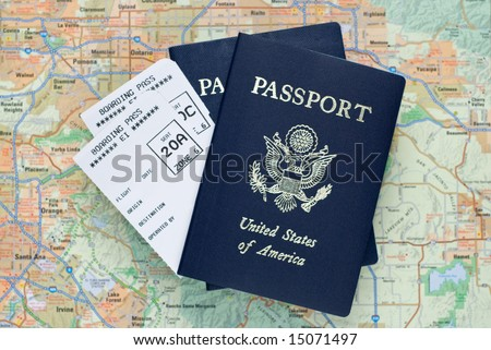 Two airplane boarding passes and two American passports, over map, selective focus - stock photo