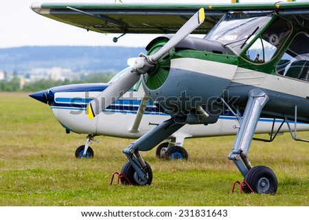 two airplanes on the airfield - stock photo