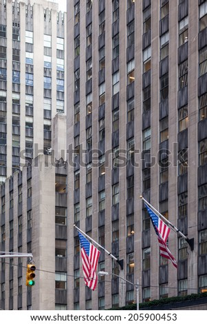 two american flags in front of business building - stock photo