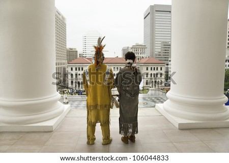 Two American Indian and Powhatan Tribal member, looking over Richmond Virginia from State Capitol during ceremonies for the 400th Anniversary of the Jamestown Settlement on May 3, 2007 - stock photo