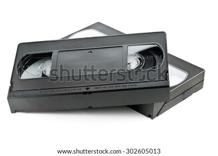 Two analog video home system (VHS) tape over white background - stock photo