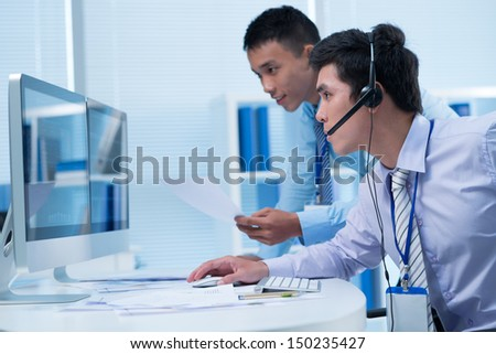 Two analysts tracing the situation at stock market - stock photo