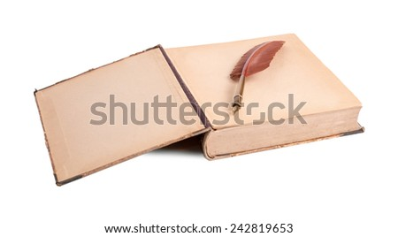 Two ancient books and feather for the letter on a white background - stock photo