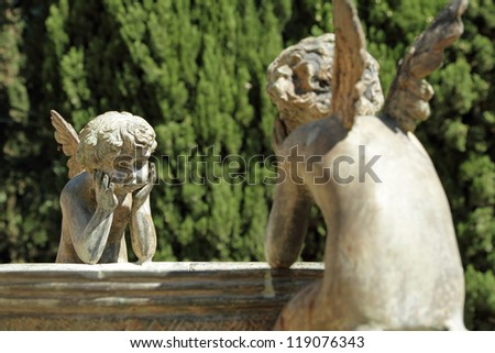 two angels - detail of the fountain in garden of Villa Peyron in Fiesole, Florence, Tuscany, Italy, Europe - stock photo