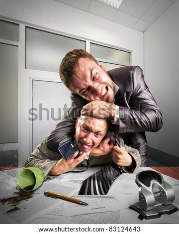 Two angry businessmen fighting for agreement signing - stock photo