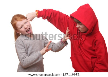 Two angry children on white background - stock photo