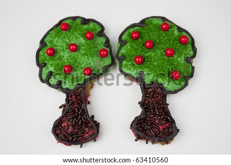 two apple (cherry) tree sugar cookies on a white background - stock photo