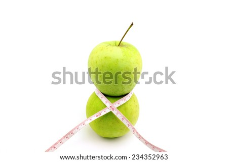 Two apples on each other represent a female figure - stock photo