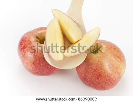 two apples with apple slices on the wooden spoon - stock photo