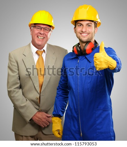 Two Architect Engineers On Gray Background - stock photo