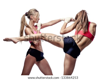 Two attractive athletic girls fighting, isolated on  white background - stock photo