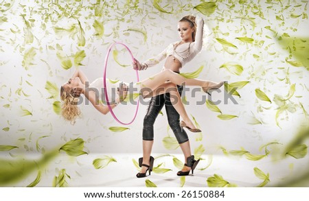 Two attractive girls exercise fitness - stock photo