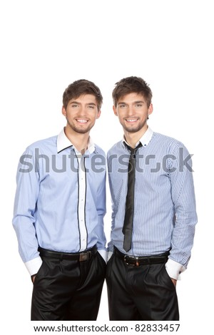 Two attractive positive smile young business people standing, dressed in shirt, tie. Concept Success, isolated over white background - stock photo