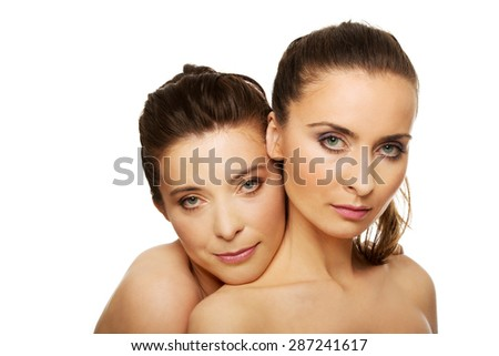 Two attractive sisters with make up. - stock photo