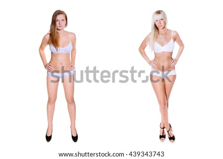 Two attractive young woman with long blond hair in white underwear and high heels, in front of white studio background - stock photo